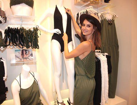 Fashion accessory, Fashion, Costume accessory, Bag, Boutique, Fashion design, Retail, Long hair, Hair accessory, Clothes hanger,