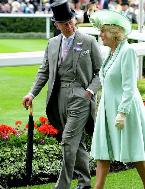 Green, Hat, Coat, Outerwear, Formal wear, Suit, Sun hat, Dress, Headgear, Fashion accessory,