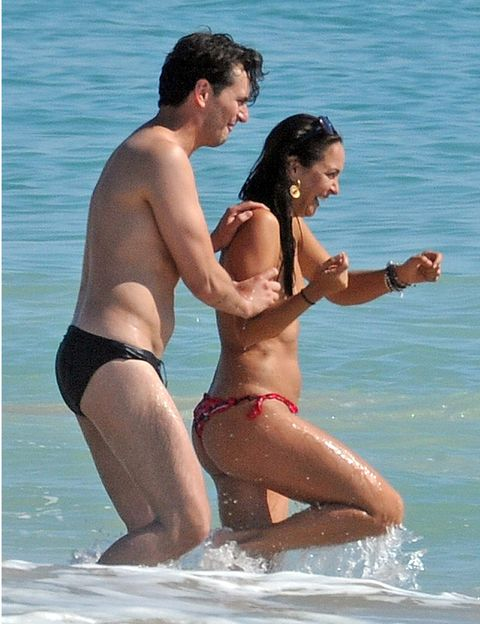 Clothing, Fun, Brassiere, Swimwear, Chest, Summer, Undergarment, Thigh, Interaction, People on beach,