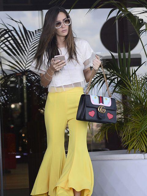 Clothing, Yellow, Waist, Fashion model, Fashion, Crop top, Street fashion, Shoulder, Leg, Footwear,