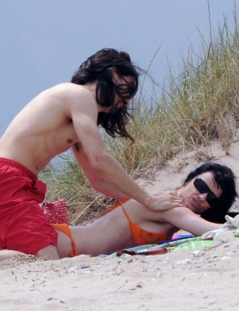 Hair, Eyewear, Fun, Human body, Brassiere, Summer, People in nature, Sand, Sunglasses, Elbow,