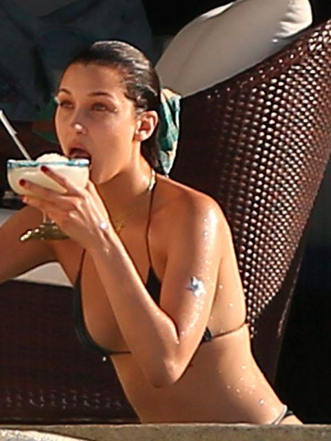 Beauty, Leg, Arm, Model, Human body, Muscle, Bikini, Sitting, Photography, Thigh,