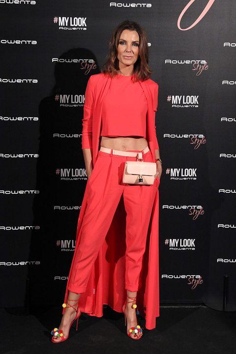 Clothing, Red, Fashion, Fashion model, Crop top, Waist, Red carpet, Shoulder, Carpet, Formal wear,