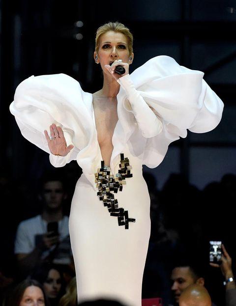 White, Performance, Fashion, Event, Lip, Human body, Performing arts, Fashion design, Singer, Haute couture,
