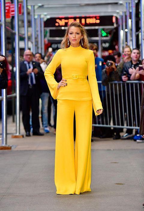 Fashion model, Yellow, Clothing, Fashion, Shoulder, Street fashion, Dress, Beauty, Orange, Haute couture,