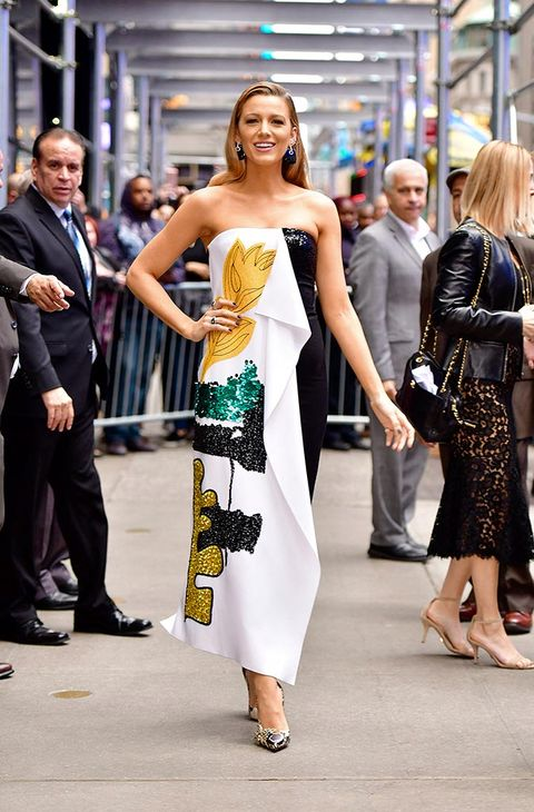 Fashion model, Fashion, Clothing, Dress, Shoulder, Street fashion, Yellow, Beauty, Haute couture, Hairstyle,