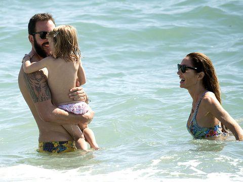 People on beach, Hair, Water, Fun, Vacation, Facial expression, Bikini, Skin, Summer, Beauty,