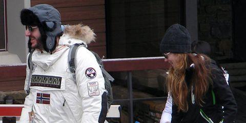 Human body, Cap, Uniform, Space, Street fashion, Baseball cap, Glove, sweatpant, Fur, Costume,