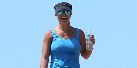 Eyewear, Goggles, Human body, Sleeveless shirt, Sunglasses, Standing, Active shorts, Elbow, Waist, Cap,