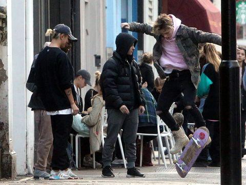 Human, Leg, Jacket, Trousers, Human body, Jeans, Coat, Outerwear, Street, Cap,
