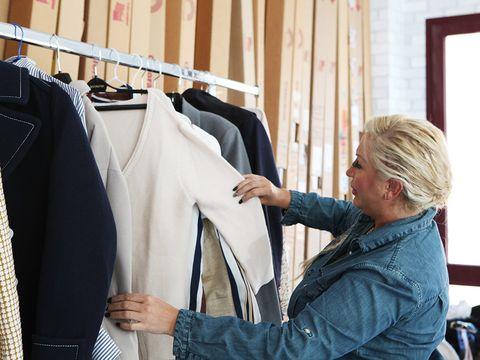 Textile, Jacket, Clothes hanger, Blazer, Conversation, Fashion design, Top, Sweater, Boutique, Outlet store,