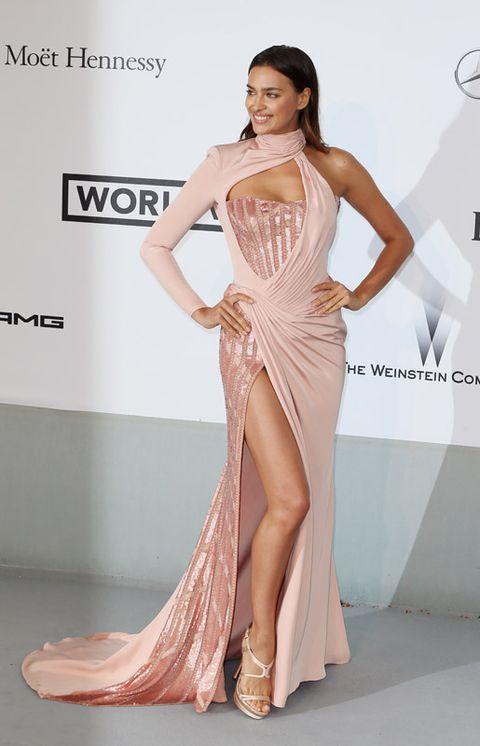 Clothing, Human, Skin, Shoulder, Dress, Joint, Formal wear, Fashion model, Style, Flooring,