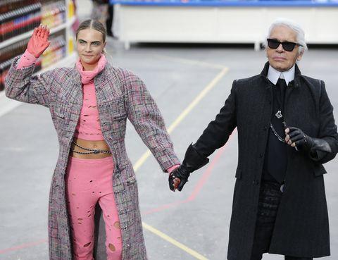 Coat, Sleeve, Trousers, Textile, Outerwear, Collar, Sunglasses, Suit, Blazer, Goggles,