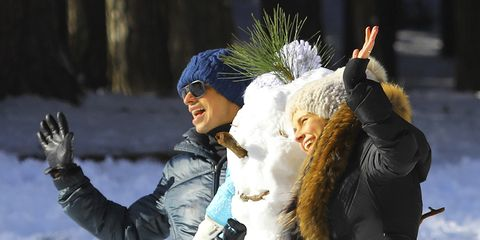 Winter, People in nature, Glove, Snow, Playing in the snow, Headpiece, Fur, Hair accessory, Goggles, Fur clothing,