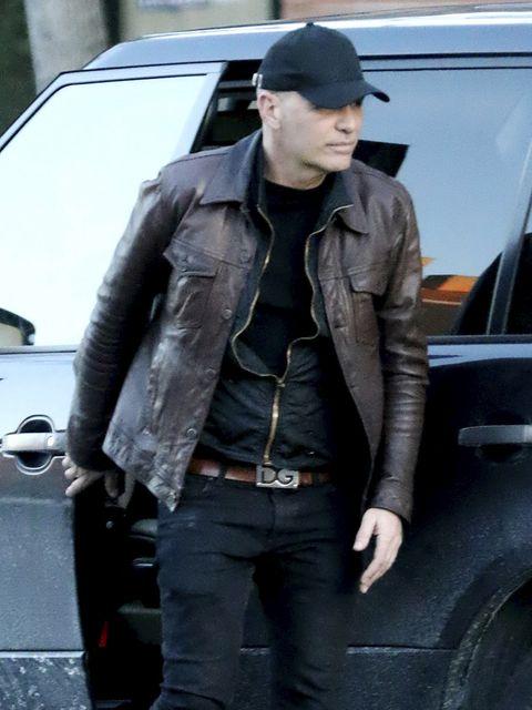 Cap, Jacket, Automotive design, Denim, Outerwear, Automotive exterior, Vehicle door, Fender, Street fashion, Pocket,