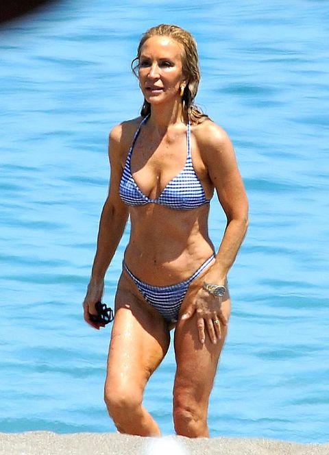Clothing, Leg, Blue, Brassiere, Human body, Swimwear, Human leg, Joint, Swimsuit top, Bikini,
