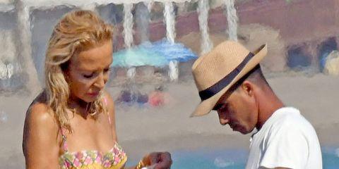 Brassiere, Hat, Summer, Interaction, Bikini, Fashion accessory, Vacation, People on beach, Undergarment, Swimsuit top,