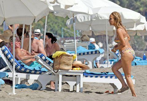 Leg, Swimwear, Hat, Summer, Leisure, Brassiere, Vacation, Bikini, Barefoot, Sun tanning,
