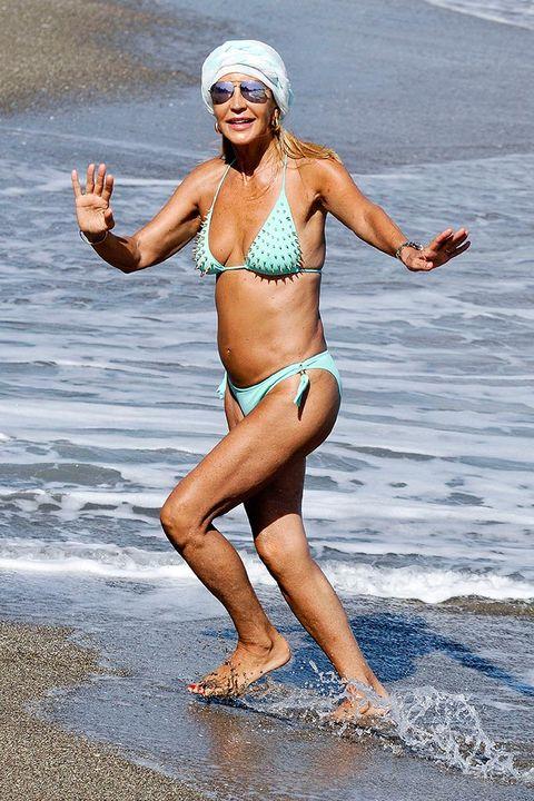 Bikini, Clothing, Swimwear, Muscle, Fun, Human leg, Leg, Thigh, Photo shoot, Summer,
