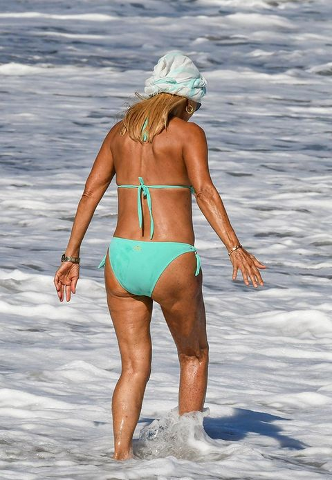 Human leg, People on beach, Summer, People in nature, Elbow, Undergarment, Muscle, Back, Swimsuit bottom, Beach,