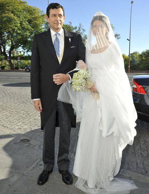 Clothing, Coat, Trousers, Bridal veil, Automotive tail & brake light, Photograph, Outerwear, Veil, Suit, Standing,