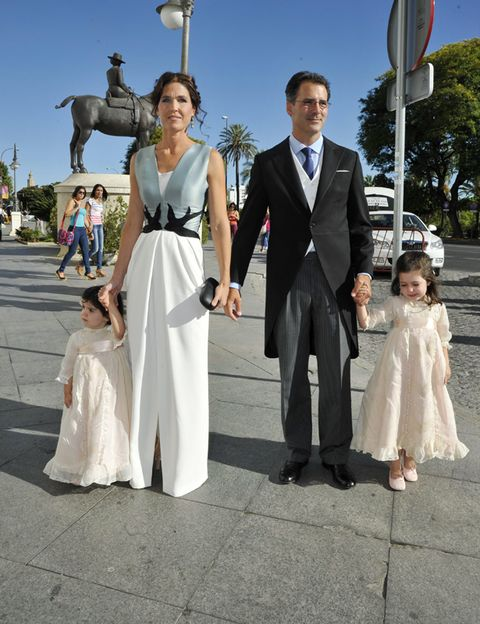 Clothing, Coat, Trousers, Dress, Shirt, Photograph, Suit, Outerwear, Formal wear, Pole,