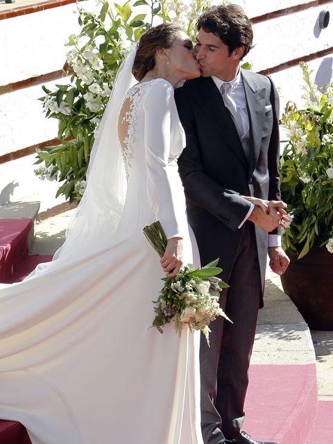 Clothing, Trousers, Coat, Bridal veil, Bridal clothing, Petal, Photograph, Suit, Dress, Outerwear,