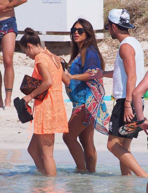Eyewear, Arm, Leg, Glasses, Fun, Human body, Tourism, Sunglasses, Summer, People on beach,