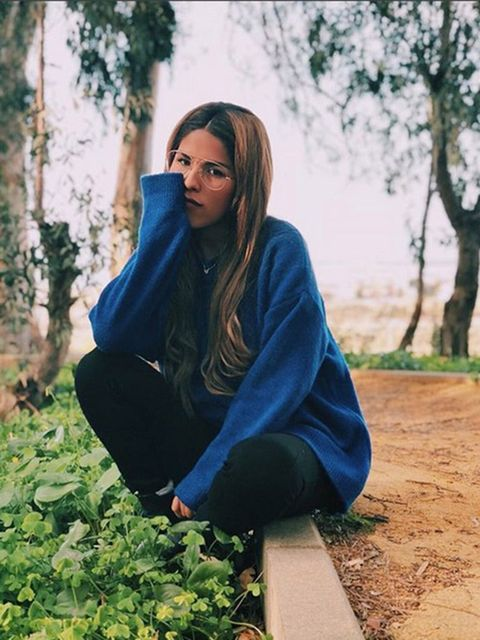 Jeans, Denim, People in nature, Sitting, Street fashion, Beauty, Electric blue, Long hair, Groundcover, Photo shoot,