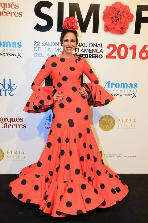 Clothing, Human, Sleeve, Red, Pattern, Style, Dress, Orange, Costume design, Costume accessory,
