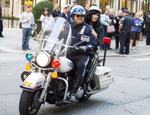 Motor vehicle, Motorcycle, Helmet, Automotive lighting, Motorcycle helmet, Personal protective equipment, Fender, Fuel tank, Headlamp, Street,