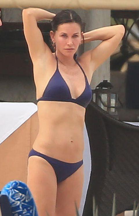 Brassiere, Human body, Shoulder, Joint, Chest, Undergarment, Swimsuit top, Trunk, Abdomen, Swimsuit bottom,