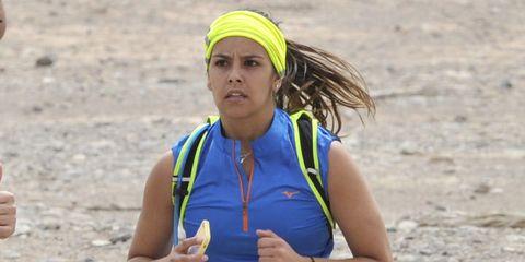 People in nature, Sleeveless shirt, Soil, Electric blue, Running, Long-distance running, Athlete, Active tank, Sand, Ultramarathon,