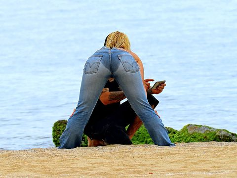Human, Jeans, Denim, Human leg, People in nature, Sitting, Knee, Back, Hip, Foot,
