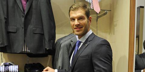 Coat, Dress shirt, Collar, Trousers, Shirt, Outerwear, Suit, Formal wear, Blazer, Bag,