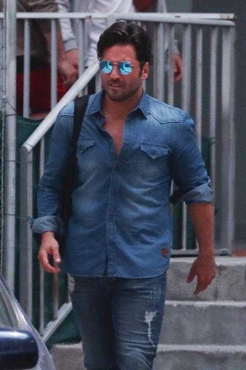Blue, Glasses, Sleeve, Denim, Shirt, Textile, Outerwear, Standing, Pocket, Street fashion,