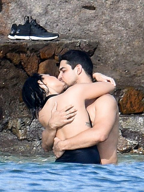 Ear, Rock, Romance, Interaction, Back, People in nature, Honeymoon, Love, Muscle, Barechested,
