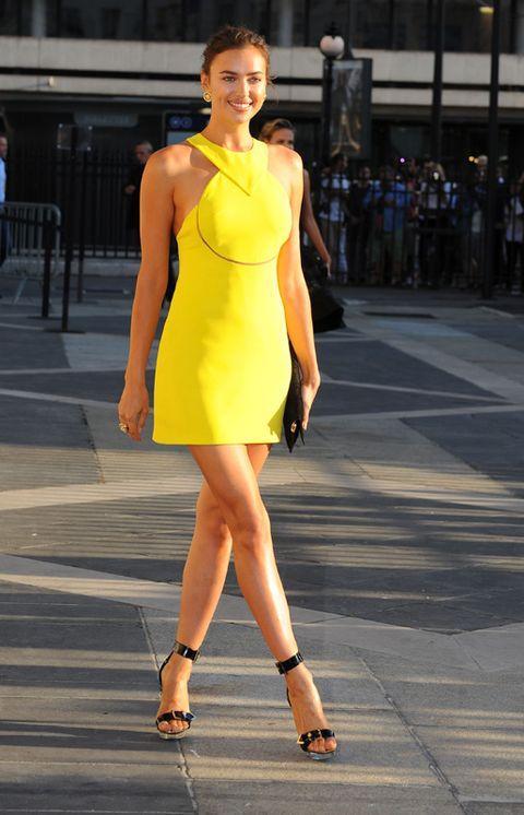 Clothing, Human leg, Shoulder, Joint, Dress, Style, One-piece garment, Street fashion, Amber, High heels,