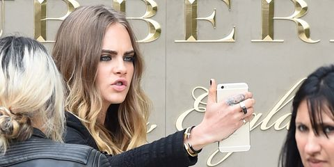 Hand, Wrist, Jacket, Eyelash, Fashion, Nail, Long hair, Blond, Street fashion, Conversation,
