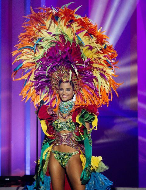 Event, Entertainment, Performing arts, Dancer, Headgear, Purple, Fashion, Costume design, Performance art, Thigh,