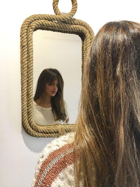 Hair, Mirror, Hairstyle, Long hair, Layered hair, Fashion accessory, Brown hair, Hair coloring, Jewellery,
