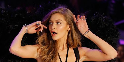 Hand, Fashion, Jewellery, Beauty, Fashion model, Thigh, Lingerie top, Model, Eyelash, Long hair,