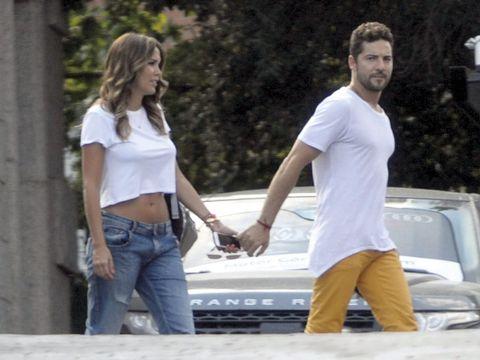 Shirt, Photograph, Denim, White, Jeans, T-shirt, Waist, Interaction, Gesture, Holding hands,