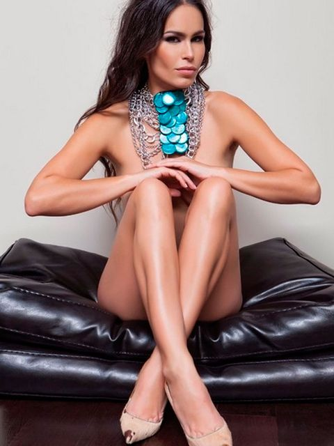 Clothing, Fashion model, Sitting, Leg, Photo shoot, Thigh, Beauty, Turquoise, Model, Dress,