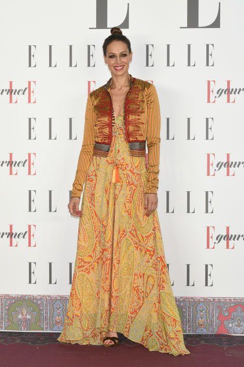 Clothing, Red carpet, Fashion model, Carpet, Fashion design, Peach, Formal wear, Dress, Yellow, Flooring,