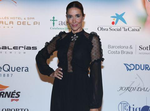 Suit, Fashion, Carpet, Formal wear, Dress, Little black dress, Fashion design, Outerwear, Event, Premiere,