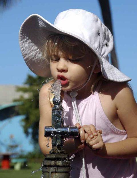 Hat, Hand, Child, Summer, Sun hat, Headgear, Costume accessory, Toddler, Sleeveless shirt, Child model,