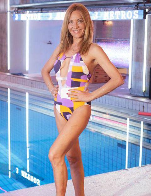 Human leg, Shoulder, Thigh, Swimwear, One-piece swimsuit, Electric blue, Model, Beauty, Long hair, Youth,