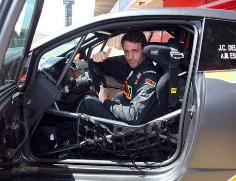 Motor vehicle, Automotive design, Vehicle, Car, Vehicle door, Logo, Windshield, Steering wheel, Automotive window part, Driving,