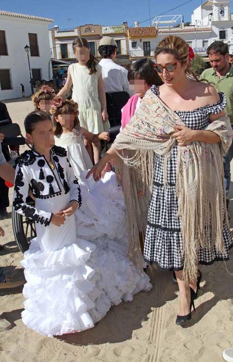 Textile, Tourism, Dress, Fashion, Sunglasses, Tradition, Embellishment, Gown, Wedding dress, Ceremony,